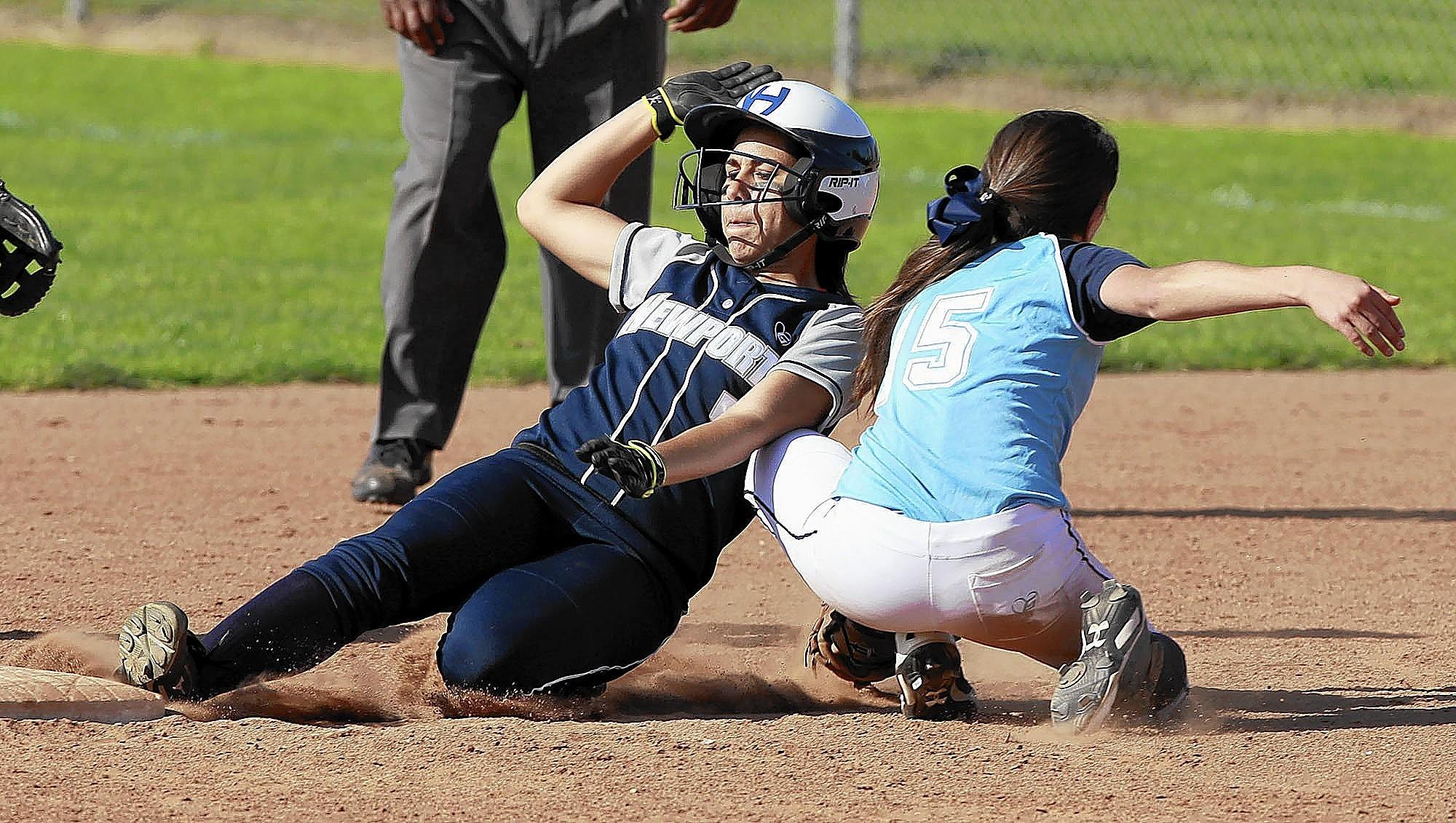 Newport Harbor High's Mariah Cruz slides into second just under the tag of Corona del Mar's Lauren Oberreiter during the Battle of the Bay softball game at Newport Harbor on Thursday.