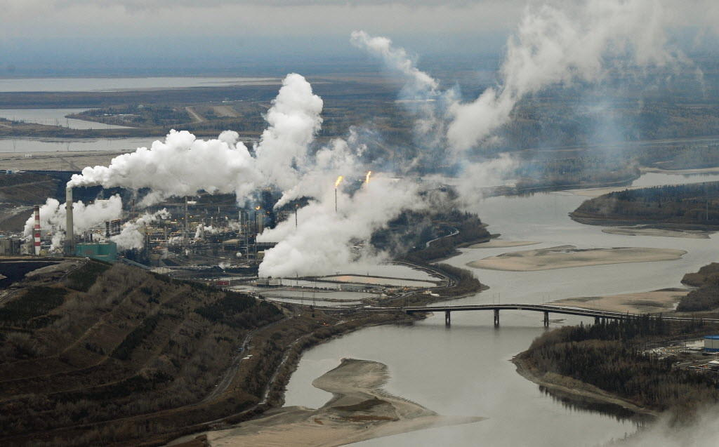 Aerial view of the Suncor oil sands extraction facility on the banks of the Athabasca River and near the town of Fort McMurray in Alberta Province, Canada.