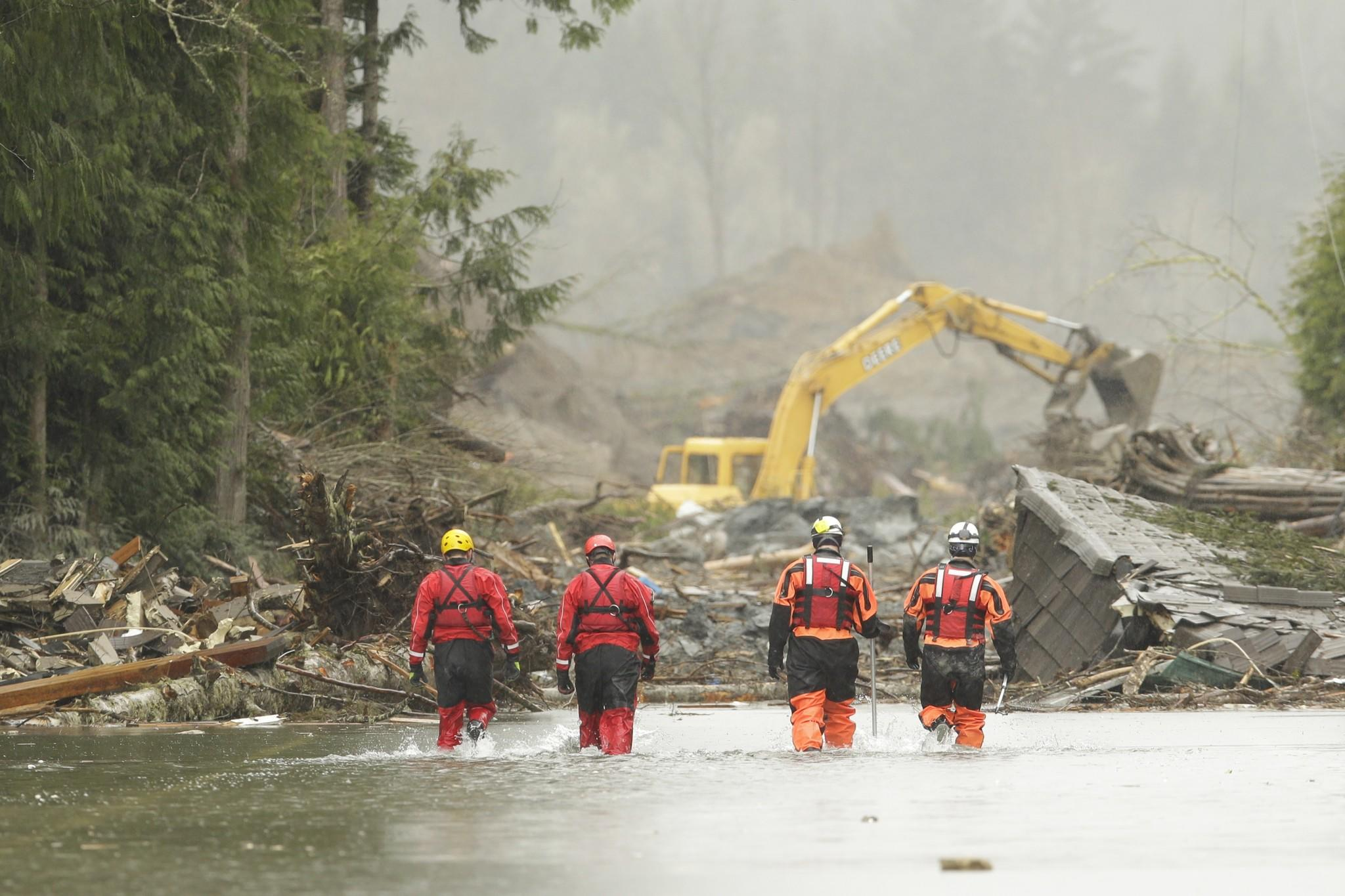 Mudslide search and rescue teams continue to work in Oso, Washington.