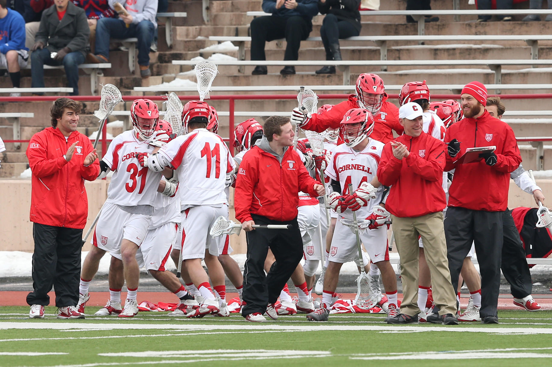 """Last year when I spoke with the team, I told them we all make mistakes,"" said Cornell interim head coach Kerwick (in white hat), who replaced Ben DeLuca in November 2013 after a hazing incident. ""I told them how I had learned so much from my mistake and it helped me grow as a person. I told them what defines a man is what you do after the mistakes and the direction we go from here will define us."""