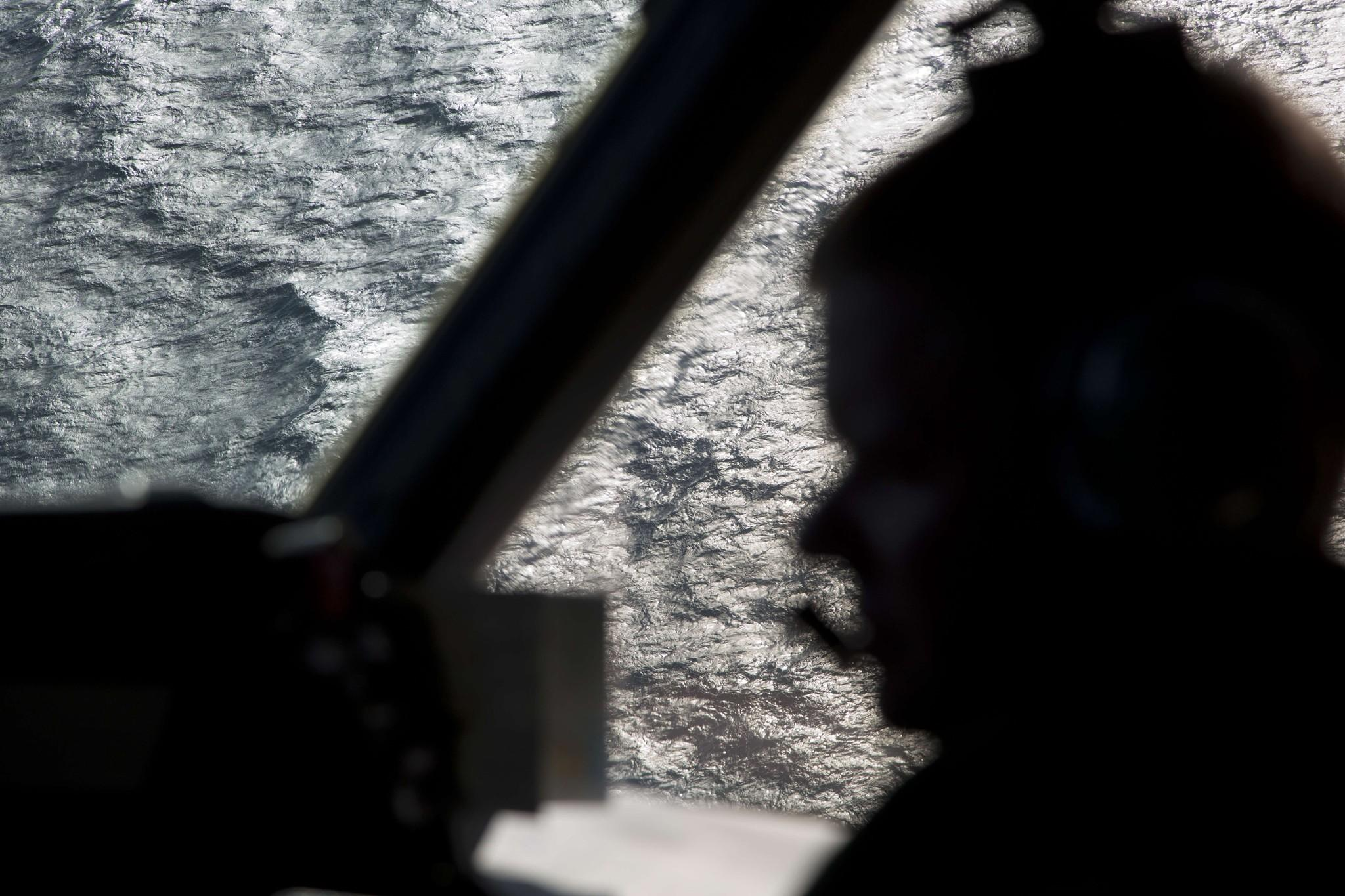 Captain Peter Moore is silhouetted against the southern Indian Ocean aboard a Royal Australian Air Force AP-3C Orion aircraft searching for the missing Malaysia Airlines flight 370 over the southern Indian Ocean on Thursday.