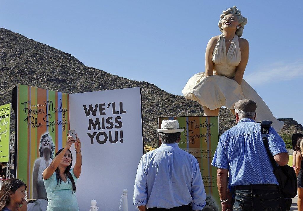 """Forever Marilyn,"" a statue by artist Seward Johnson, attracts fans of the late movie star in Palm Springs. The work is moving to New Jersey."