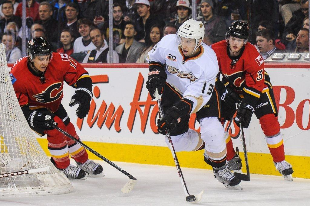 Nick Bonino skates with the puck.