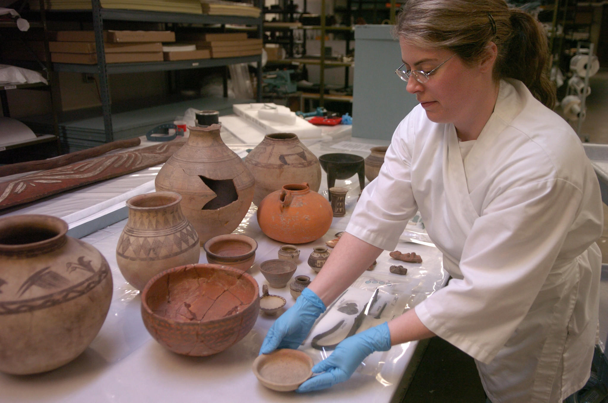 Collections assistant Sarah Coleman works with ancient Persian artifacts at the Field Museum in 2006.