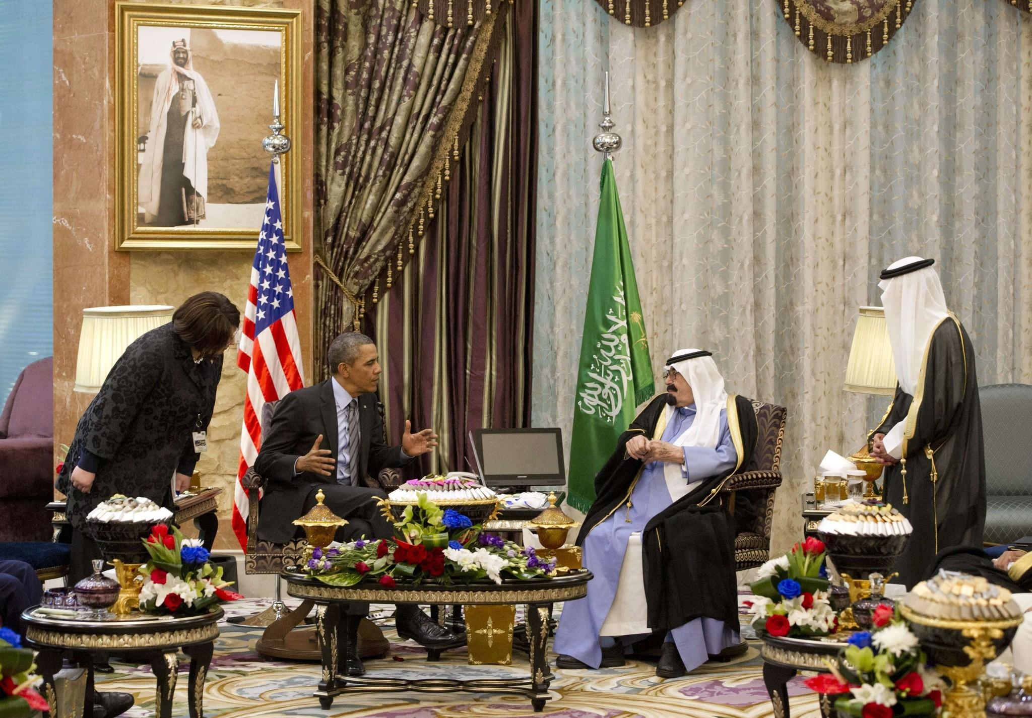 President Obama and Saudi King Abdullah meet with interpreters nearby at the monarch's desert camp northeast of Riyadh.