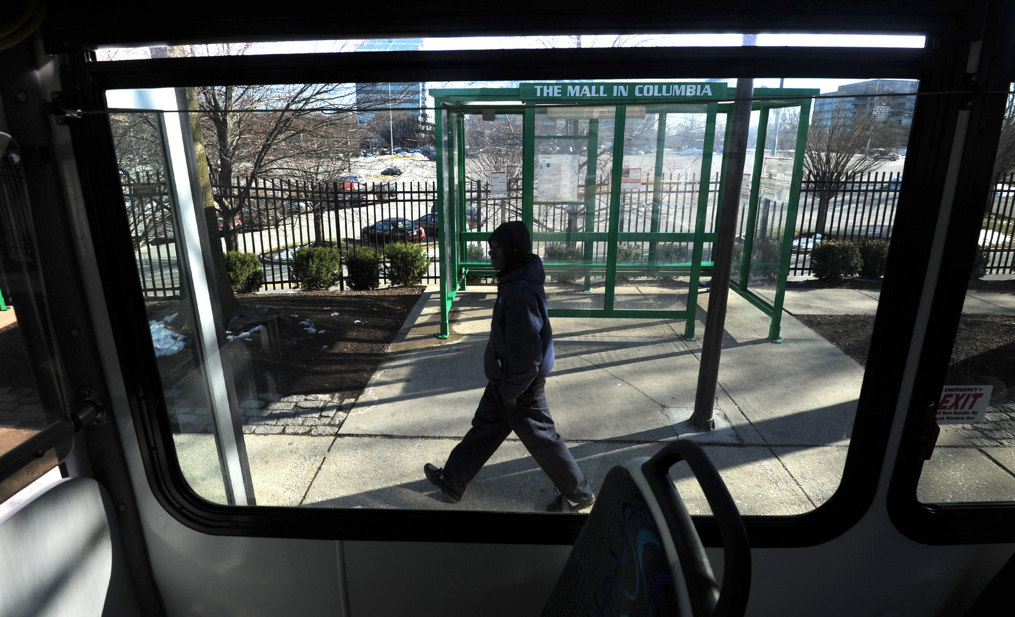 A pedestrian walks by the regional transit agency bus at the Columbia Mall near Sears.