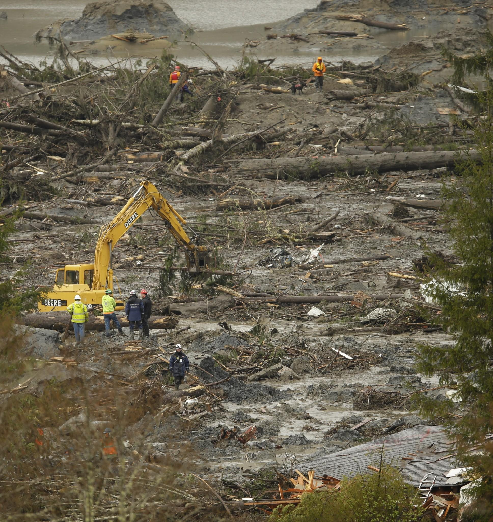 Search and rescue teams continue to work in Oso, Wash.