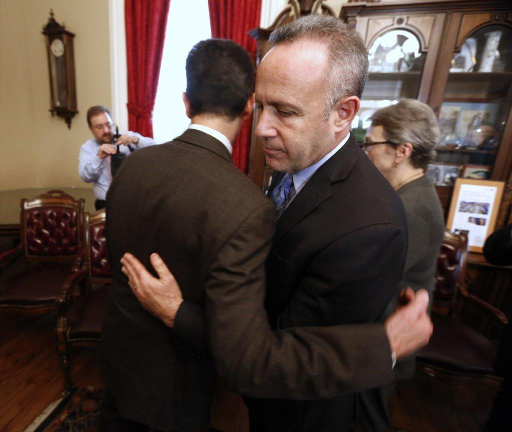 State Senate President Pro Tem Darrell Steinberg (D-Sacramento), right, is consoled by Sen. Mark Leno (D-San Francisco) after he and fellow Democrats on Wednesday called on Sen. Leland Yee (D-San Francisco) to resign in the wake of his arrest on federal corruption and firearm charges.