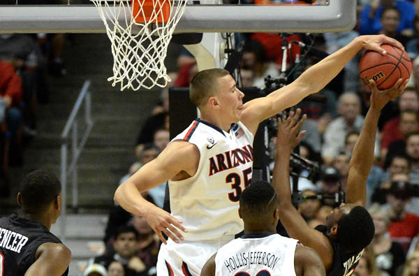 Arizona center Kaleb Tarczewski, a 7-foot sophomore, blocks a shot by San Diego State guard Xavier Thomas in the West Regional semifinal on Thursday.