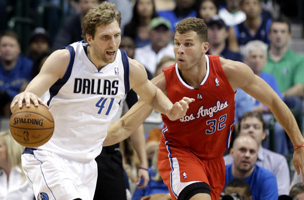 Clippers power forward Blake Griffin tries to cut off a drive by Mavericks power forward Dirk Nowitzki during their game Thursday night in Dallas.