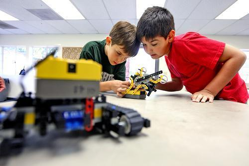 Spencer Solberg, 9, and Julian Grigorian, 9, take a closer look a Lego robot during a robotics class at Verdugo Park on Thursday, March 27, 2014.