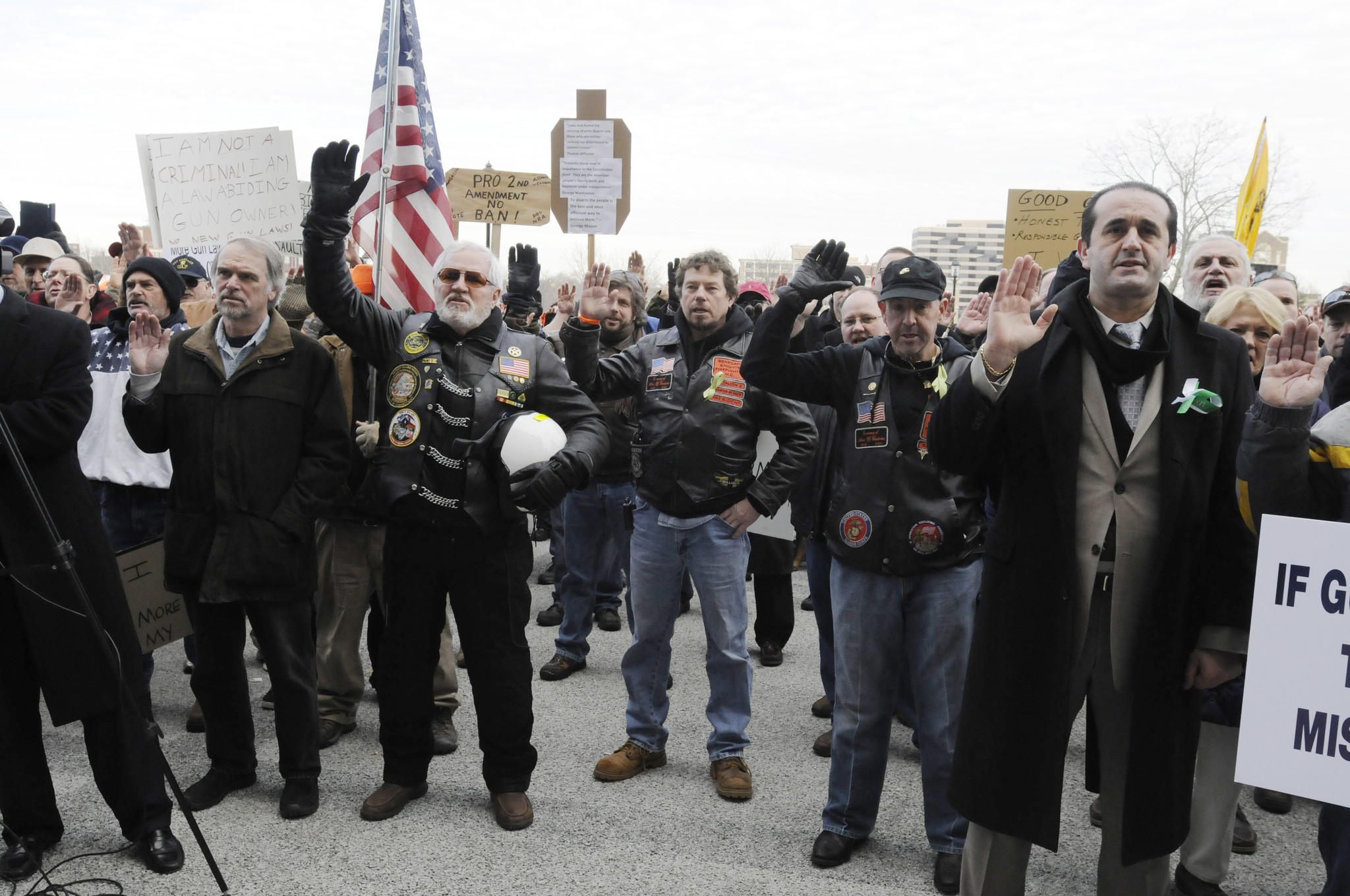 Gun rights supporters take an oath to uphold the Constitution at Gun Appreciation Day in Hartford on Jan. 19, 2013.