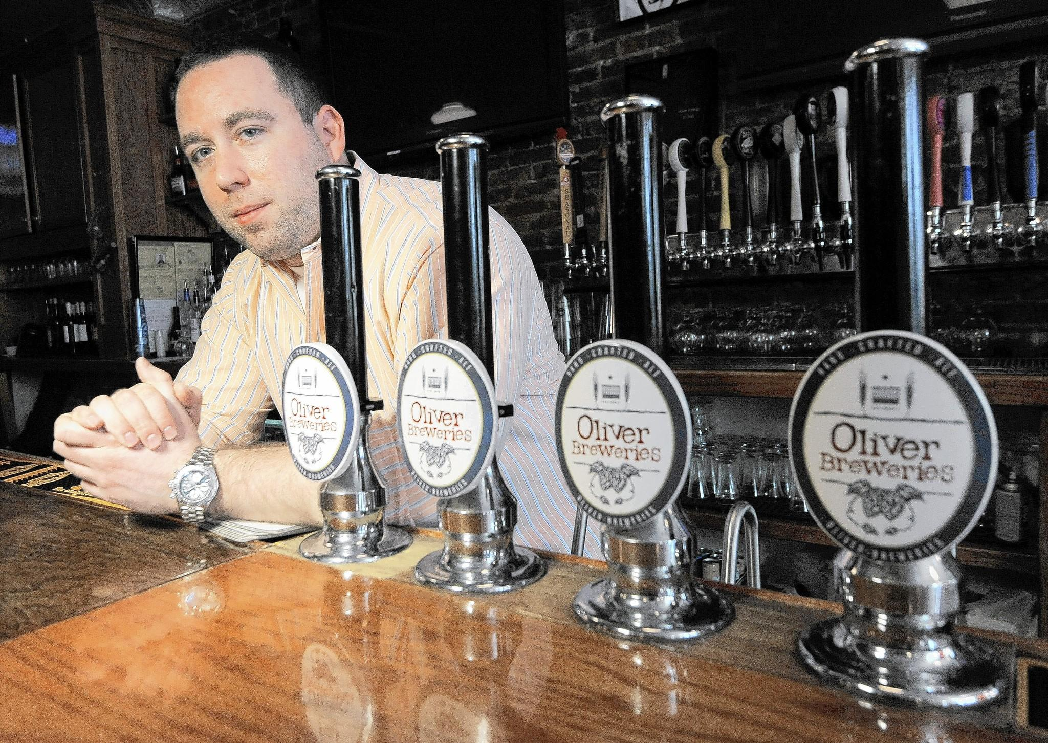 Justin Dvorkin, co-owner of Oliver Breweries, in the bar of Pratt Street Alehouse. Oliver ales and beer are currently made here, but production is set move to Clifton Park.