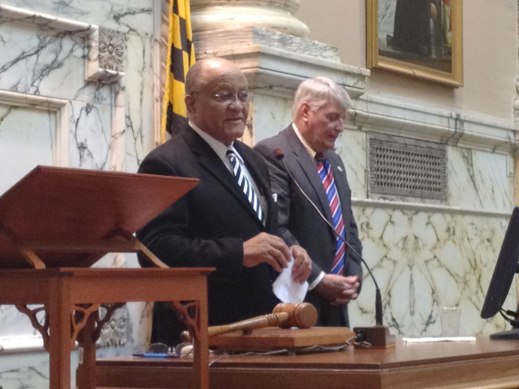 Del. Rudy Cane (left) leaves House. House Speaker Michael E. Busch (right)