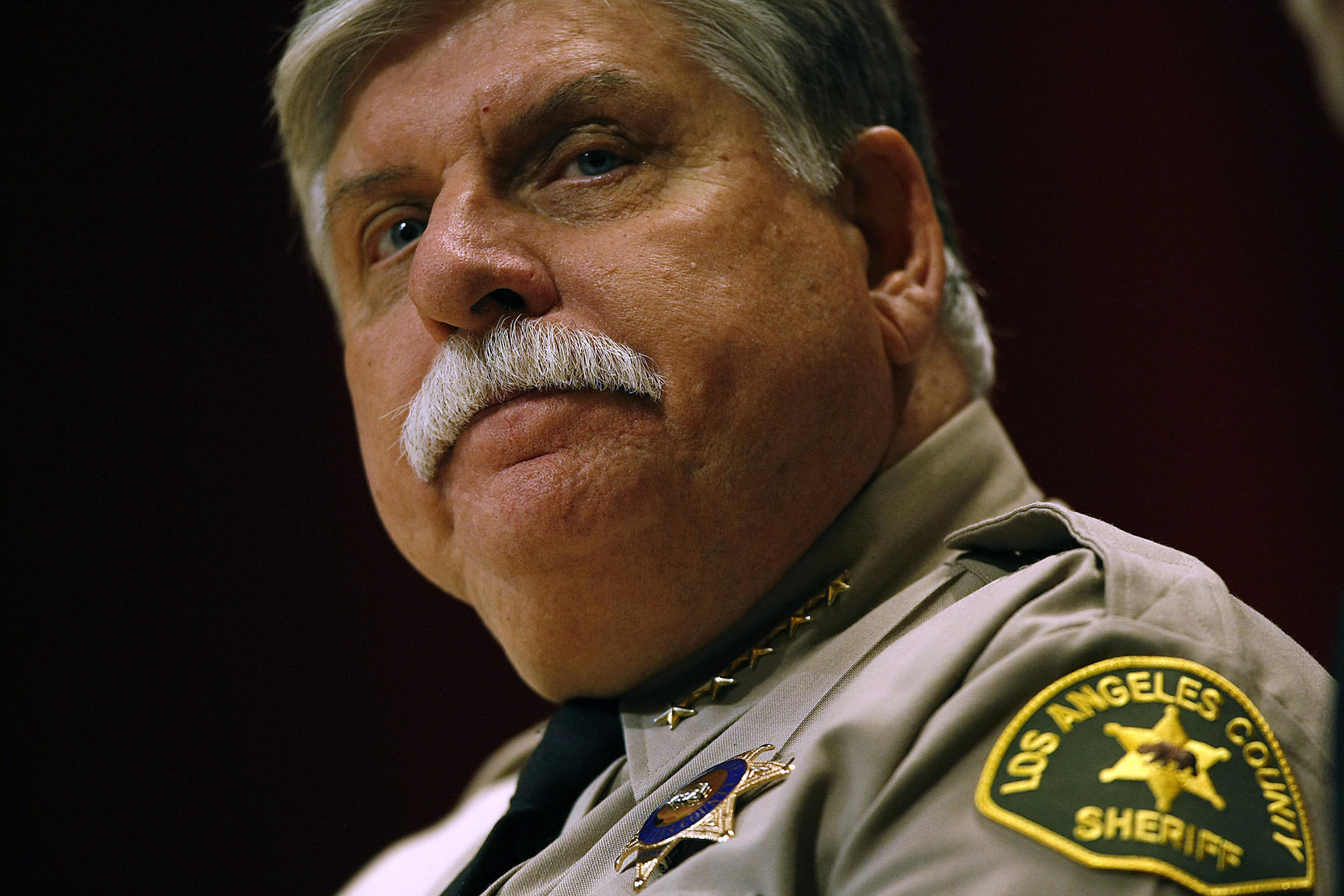 Interim L.A. County Sheriff John Scott presides over the ceremony for 48 academy graduates at East L.A. College.