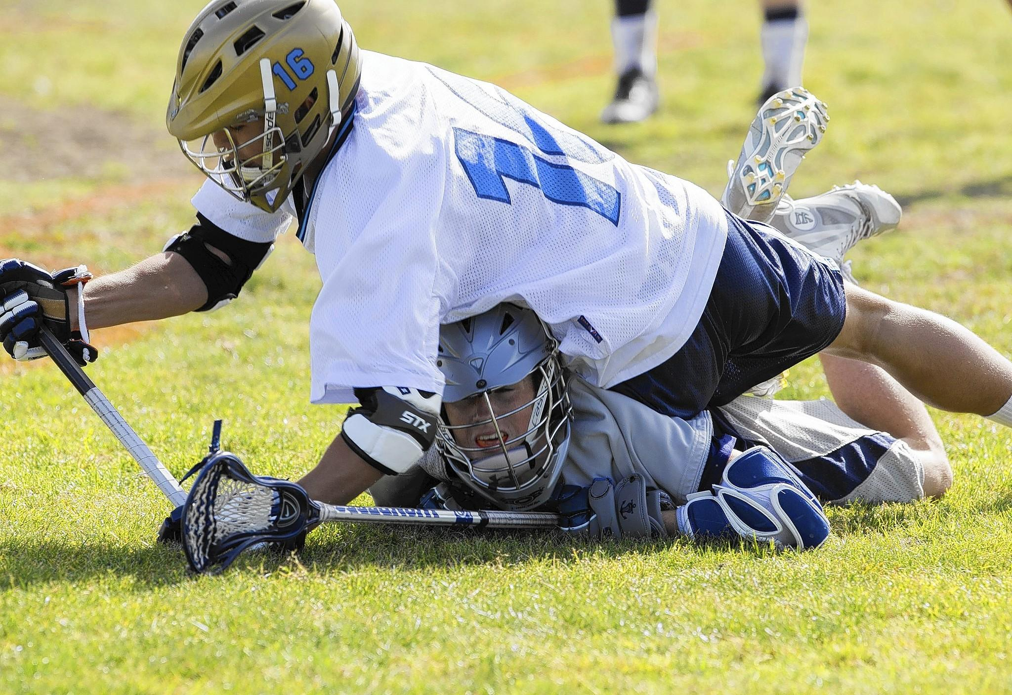 Corona del Mar's Daniel McCabe falls over Newport Harbor's John Mooers during the Battle of the Bay on Friday.