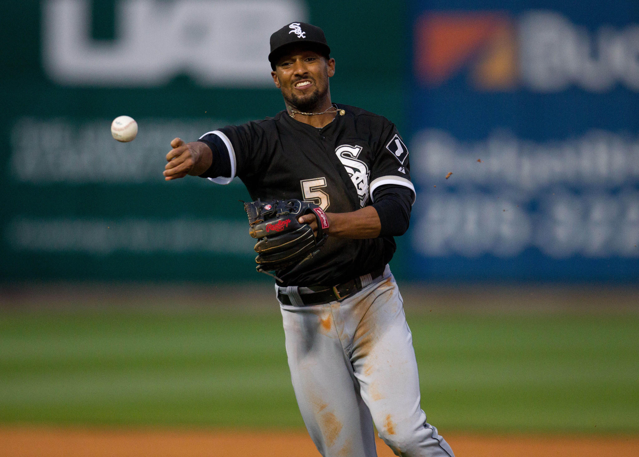 White Sox second baseman Marcus Semien throws the ball to first during the game against the Birmingham Barons at Regions Field.