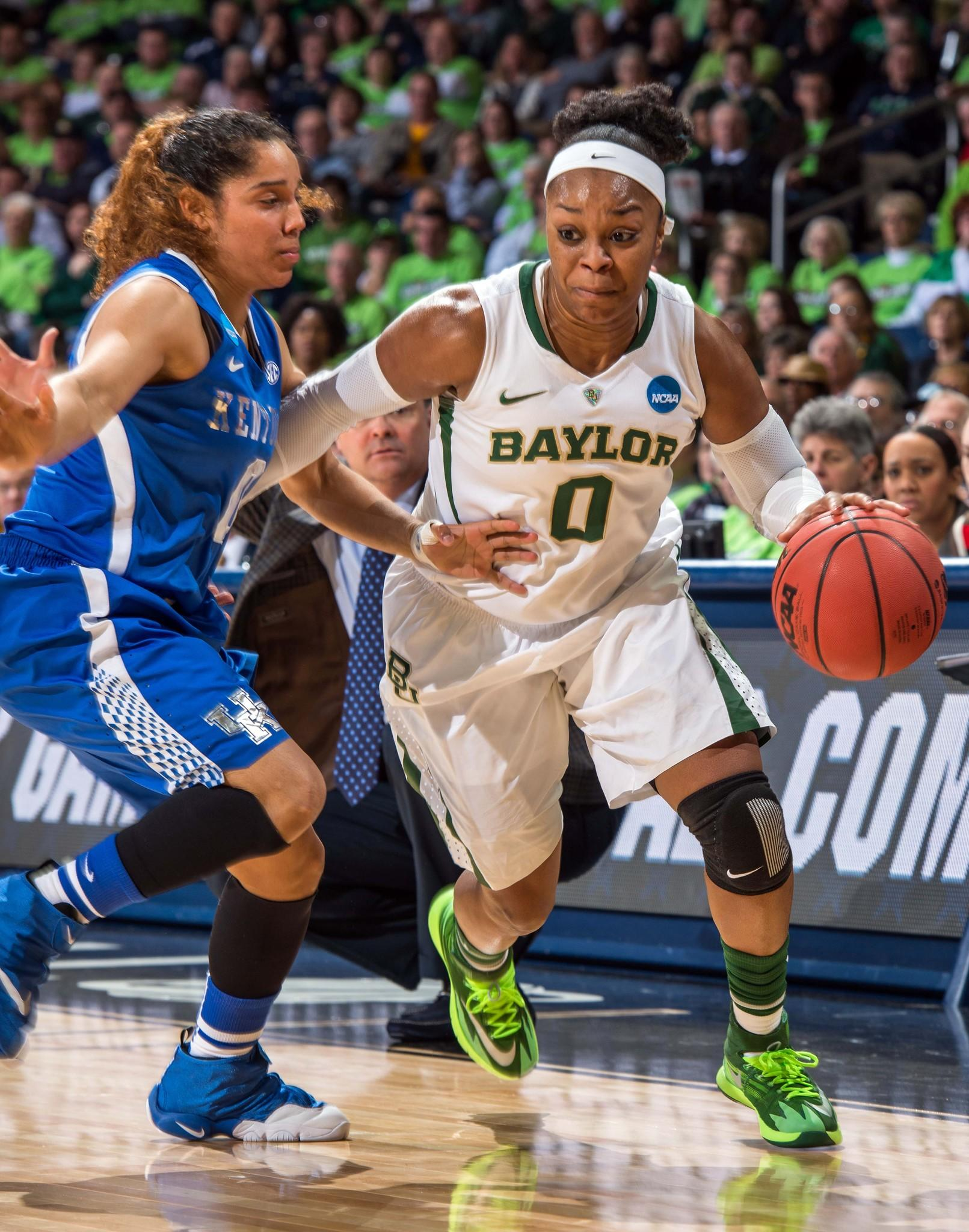Baylor Bears guard Odyssey Sims dribbles as Kentucky guard Jennifer O'Neill defends.
