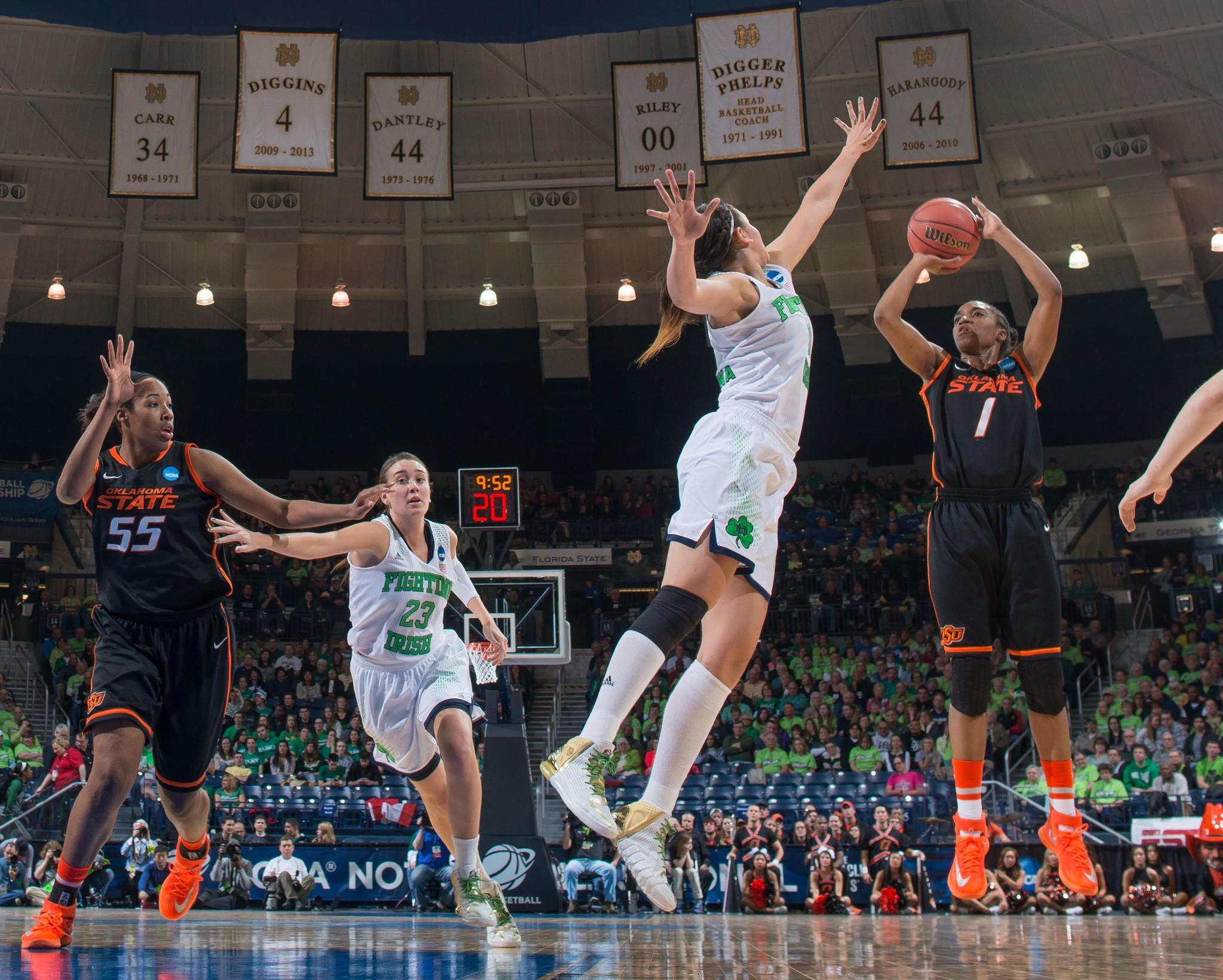 Oklahoma State Cowgirls guard Brittany Atkins (1) shoots as Notre Dame Fighting Irish forward Natalie Achonwa (11) defends in the first half in the semifinals of a women's college basketball game in the Notre Dame regional of the 2014 NCAA Tournament at the Purcell Pavilion.