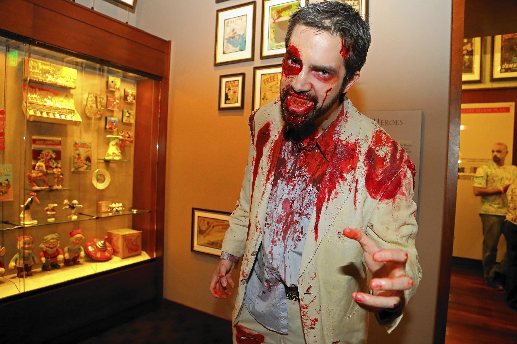 "Casey Driskill, 29, otherwise known as the ""Great White Zombie"", participated in the fourth annual Zombie Gras held at Geppi's Entertainment Museum on Saturday."