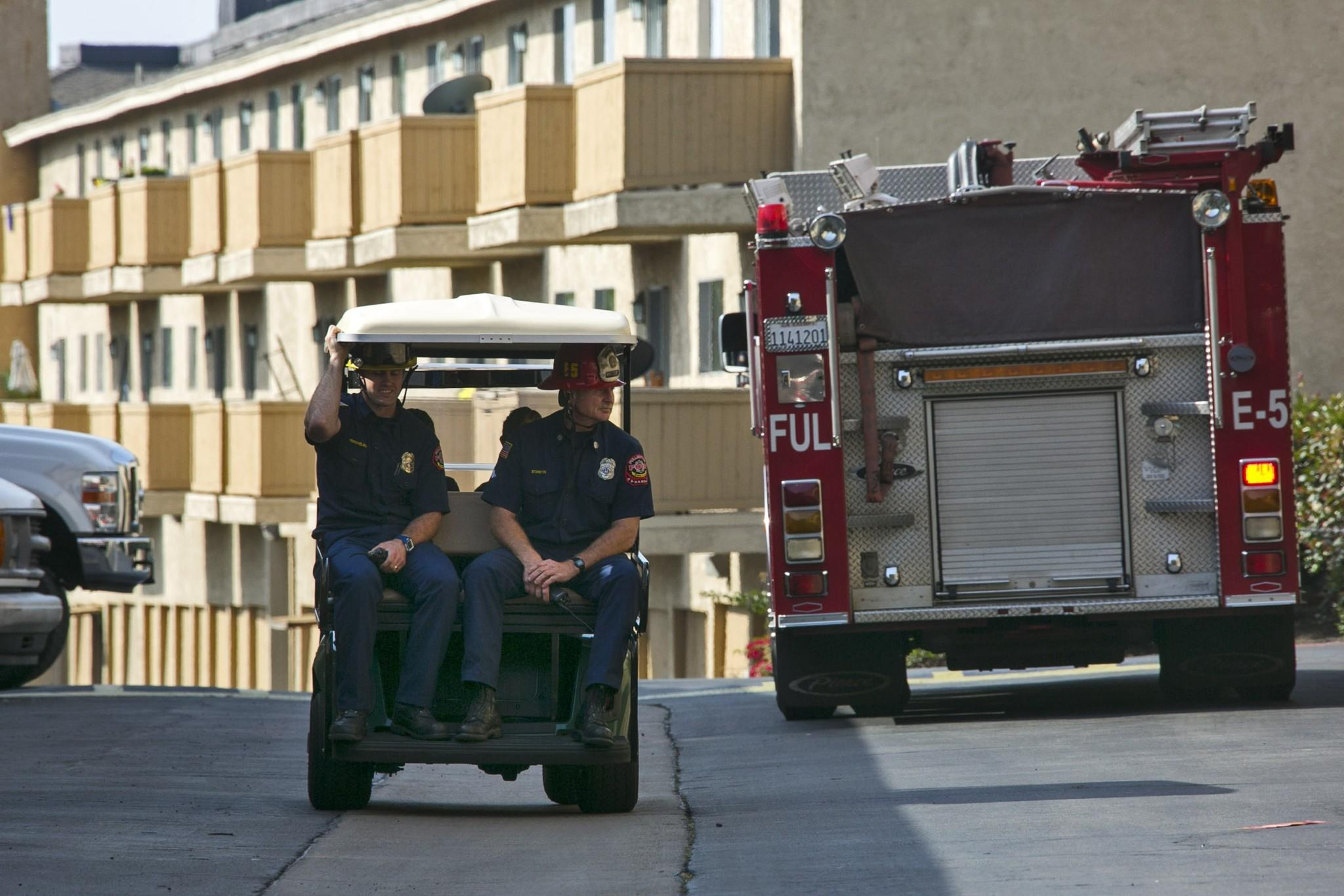 The Fullerton Fire Department checks for damage to an apartment complex on the 2600 block of Associated Road in Fullerton after Friday's 5.1 earthquake.