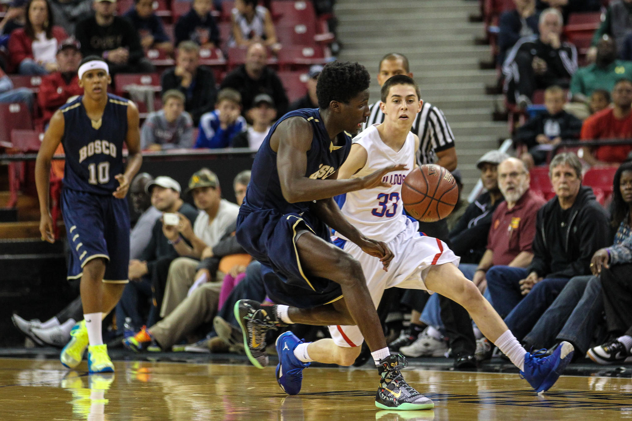 St. John Bosco forward Daniel Hamilton (left) is guarded by Folsom's Alec Andrews in the first half of the Division II state final at Sleep Train Arena in Sacramento.