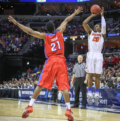 Florida's Michael Frazier II (20) goes up for a three point shot during second half action of an NCAA Elite 8 southern regional final against Dayton at the FedEx Forum in Memphis, TN on Saturday, March 29, 2014. (Joshua C. Cruey/Orlando Sentinel)