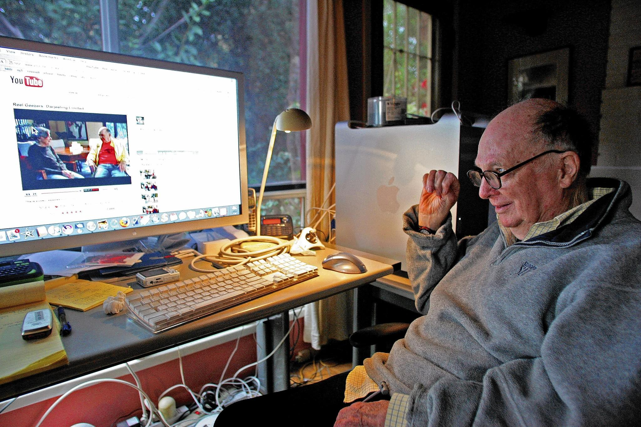 "In this photo from 2007, screenwriter Lorenzo Semple Jr. watches a clip of himself and veteran agent Marcia Nasatir on ""Reel Geezers,"" an online show in which the pair would give acerbic reviews of current fims."