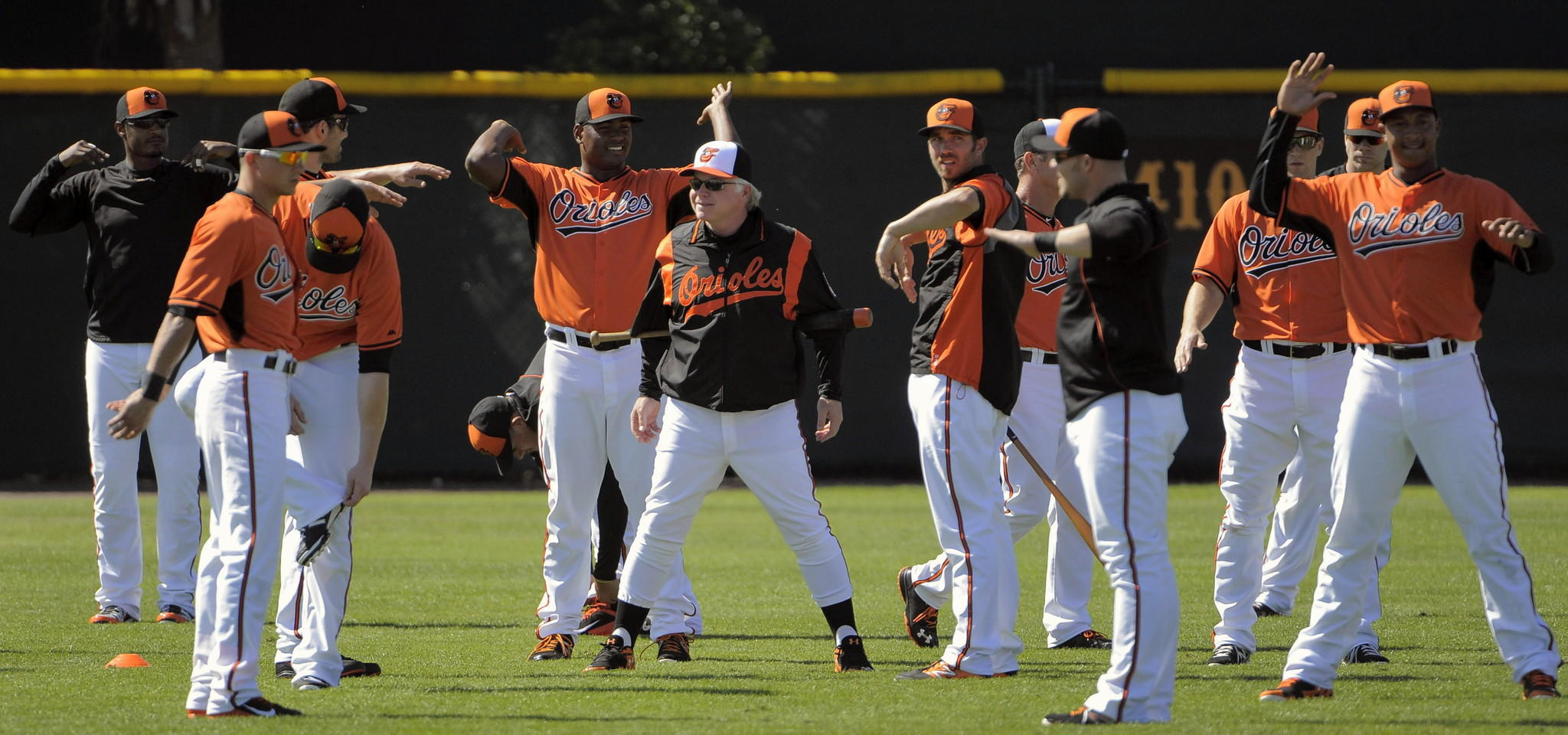 Orioles manager Buck Showalter smiles while standing among his players during the first official day of spring training workouts at the club's facility in February.