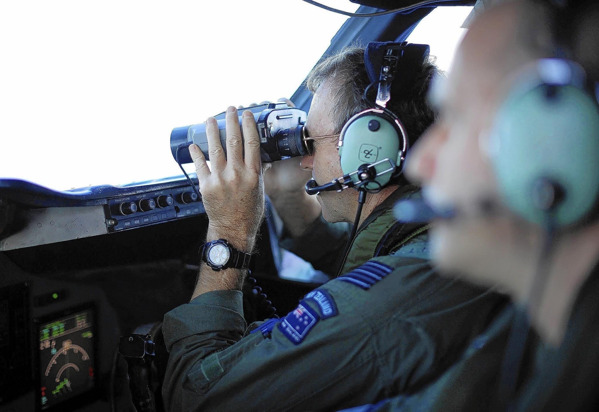 New Zealand Wing Cmdr. Rob Shearer takes a closer look at a site in the Indian Ocean during the search for Flight 370.