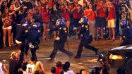 Tucson police pepper spray, arrest unruly fans after Arizona loss