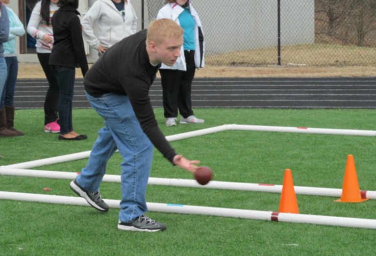 Jordan Beck, a student at Broadneck High School in Annapolis, bowls a bocce ball during practice.