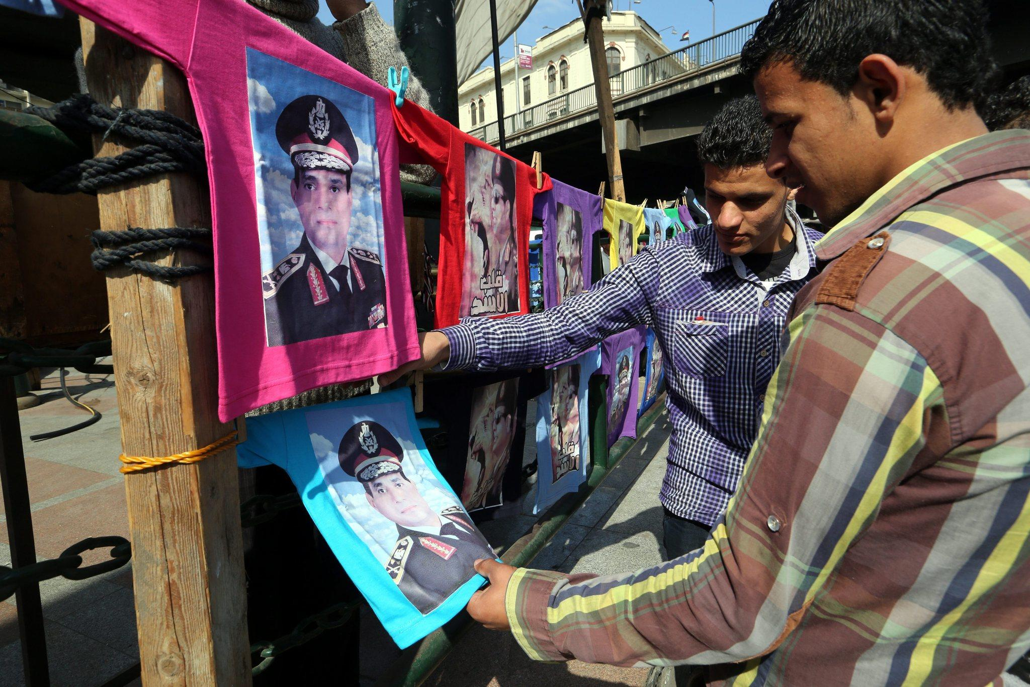 Egyptian officials announced that the first round of the country's presidential election, which former Field Marshal Abdel Fattah Sisi is widely expected to win, will be held May 26 and 27. Above, T-shirts displaying photos of Sisi are offered for sale in Cairo.