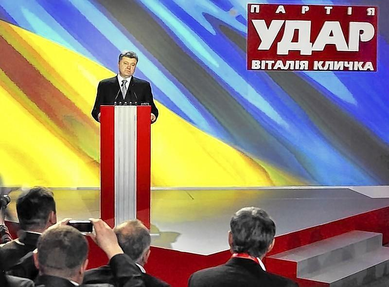Ukrainian politician Petro Poroshenko addresses members of an UDAR party Sunday during a meeting in Kiev.