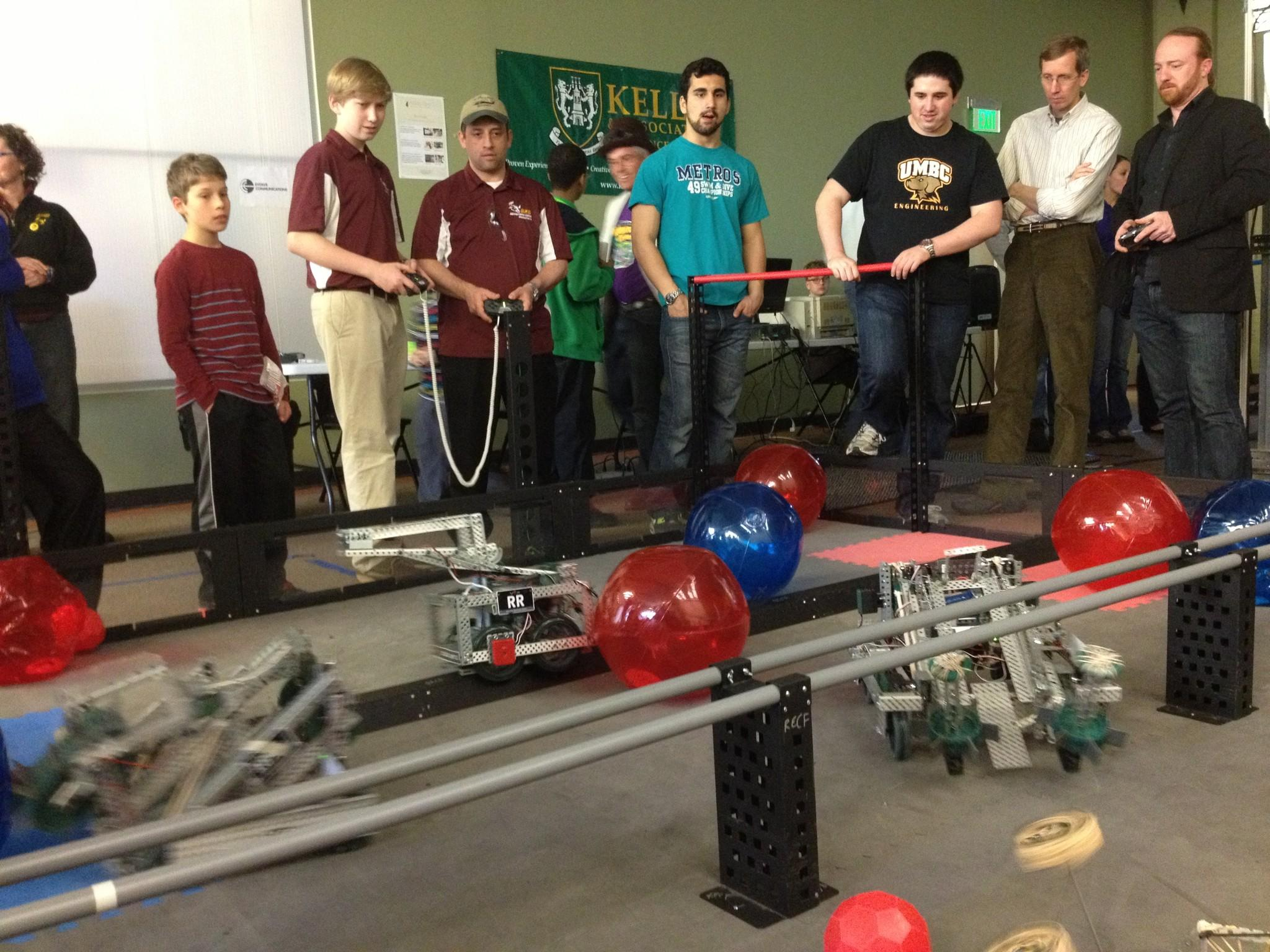 The Baltimore Robotics Center held a charity tournament to benefit teams in the Vex High School Robotics League, featuring area CEOs as competitors operating robots built by students.