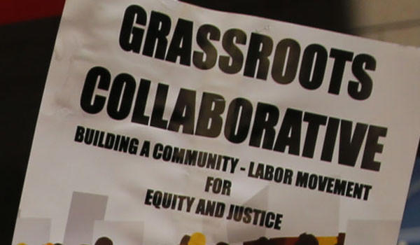 Protest sign for Grassroots Collaborative in 2013.