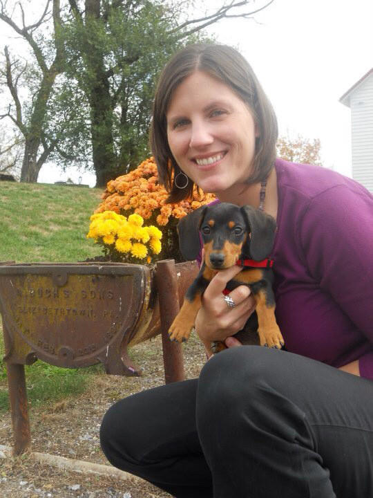 Monica Barlow photographed holding their family pet, Dasher, their miniature dachshund in fall 2010.