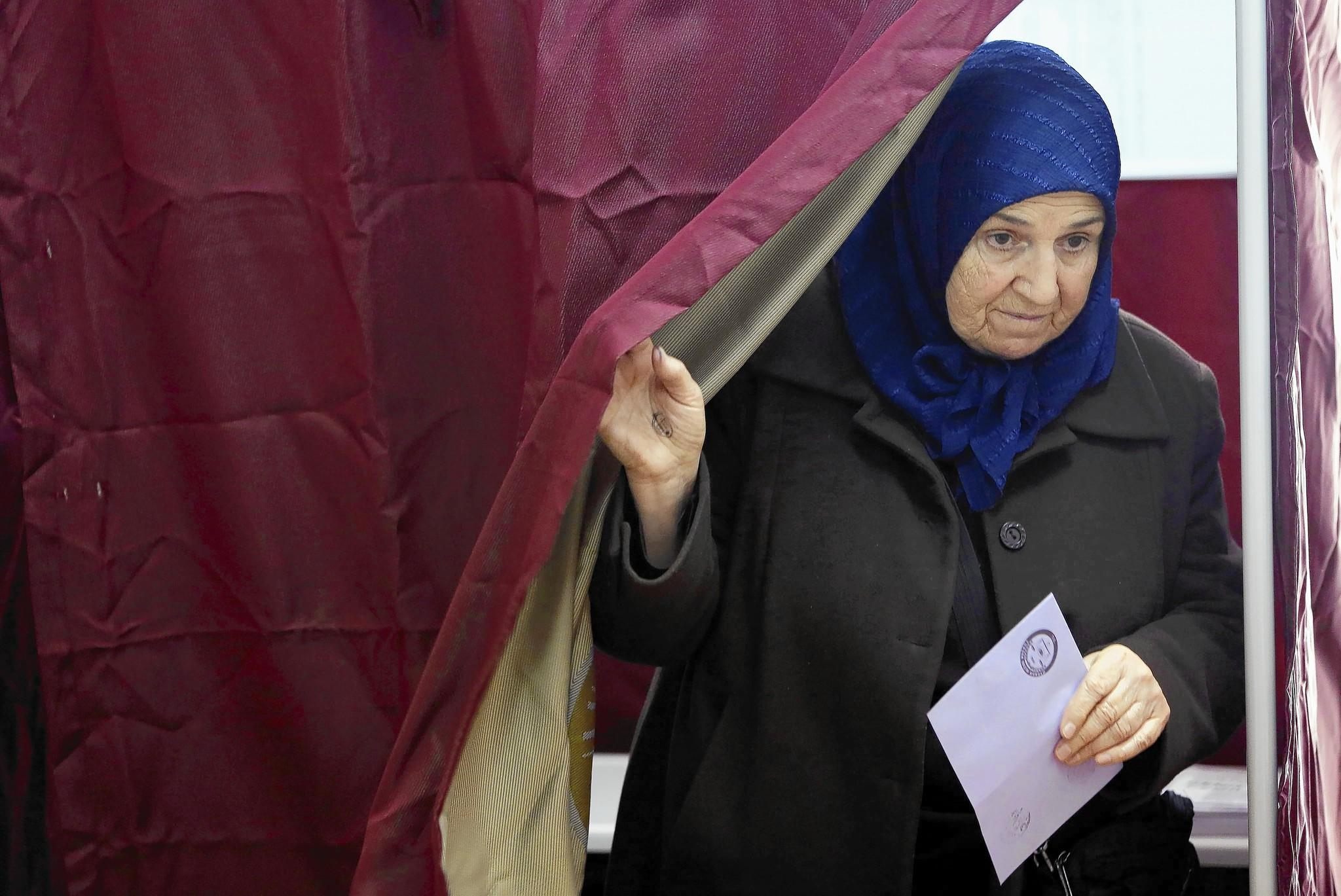 A woman votes in Istanbul during Turkey's municipal elections.