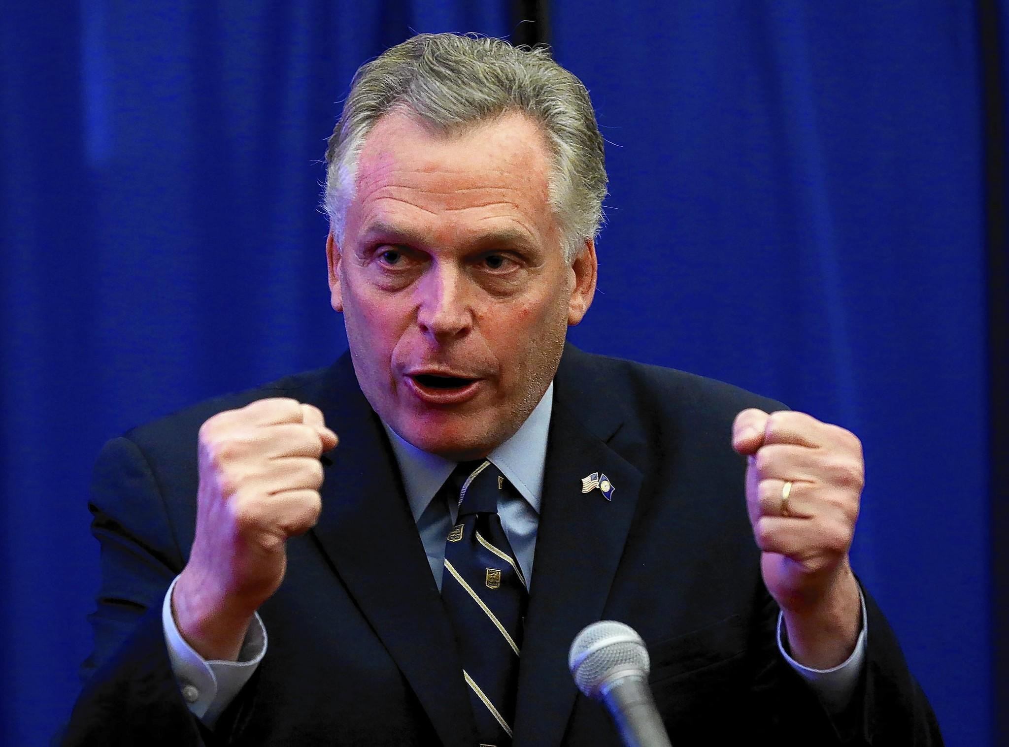 Virginia Gov. Terry McAuliffe gestures during a news conference in Richmond. His success in boosting the Democratic turnout in the election he won last year has made the campaign a hopeful model for this year's Democratic candidates.