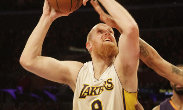 Lakers center Chris Kaman puts up a shot during the team's 115-99 win over the Phoenix Suns at Staples Center on Sunday. Kaman finished with 28 points and 17 rebounds in the win.