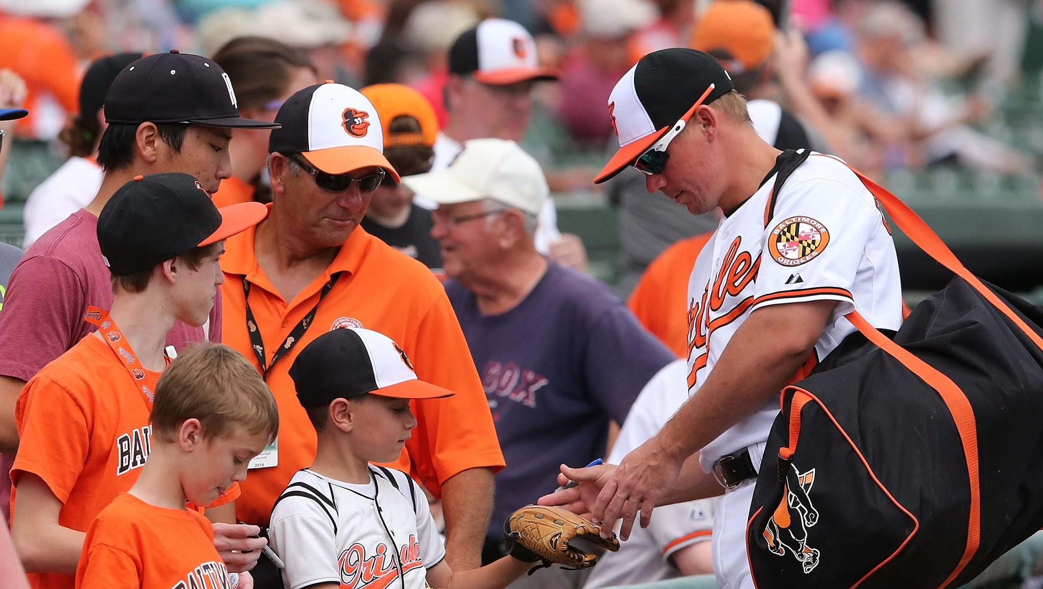 Steve Clevenger signs autographs before a game against the Boston Red Sox this spring.