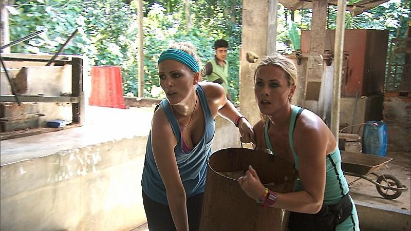 """Country singers Jennifer (left) and Caroline must make five sheets of paper using elephant dung and scraps of paper on """"The Amazing Race."""""""