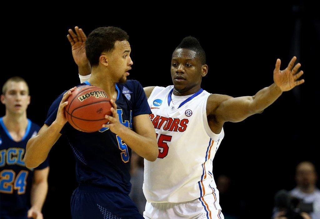 Florida's Will Yeguete guards UCLA's Kyle Anderson on March 27.