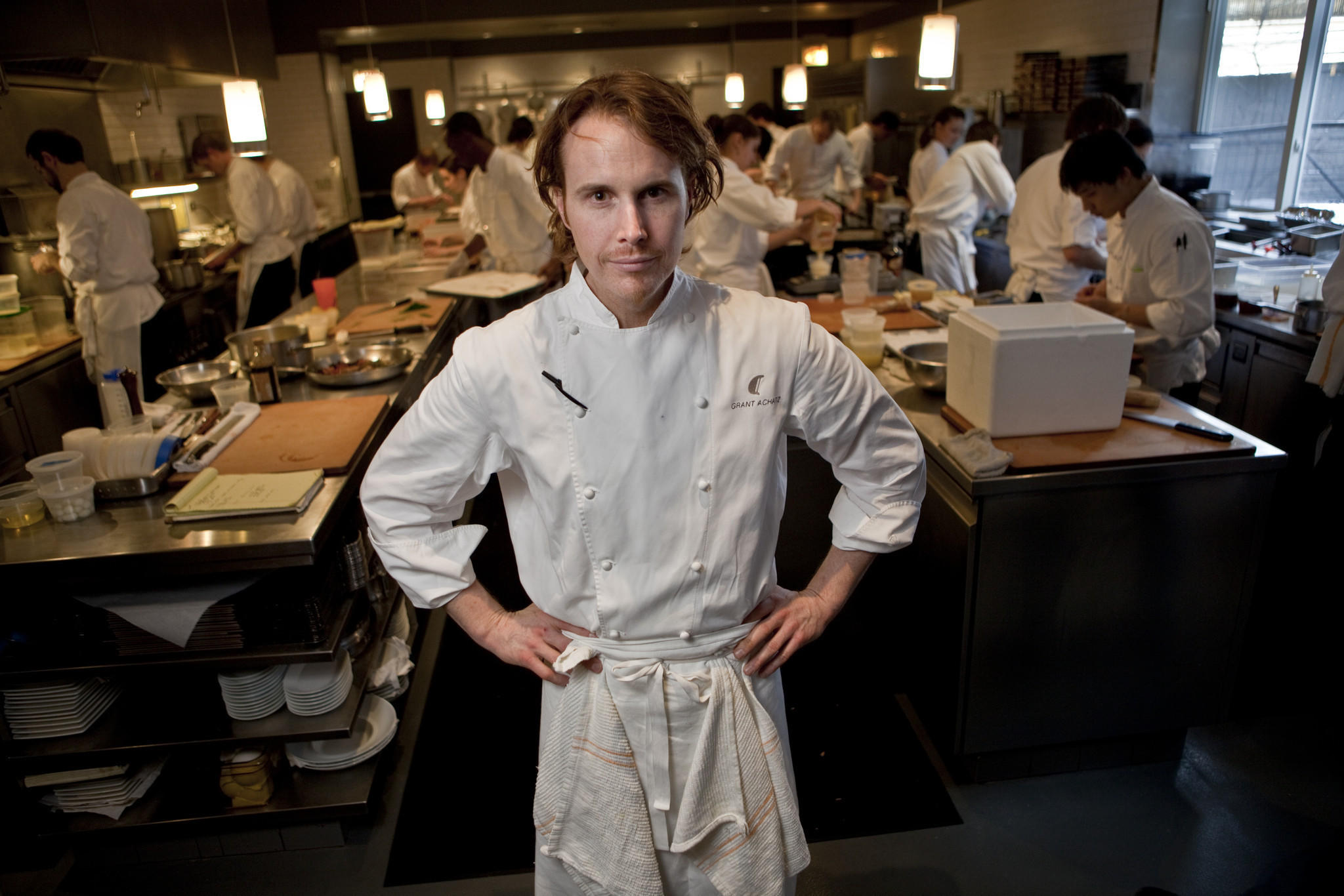 Chef Grant Achatz works in the kitchen of his restaurant Alinea.