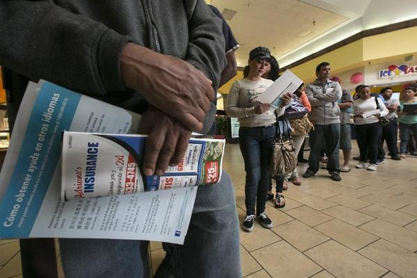 Customers line up in Panorama City CA over the weekend to sign up for Obamacare.