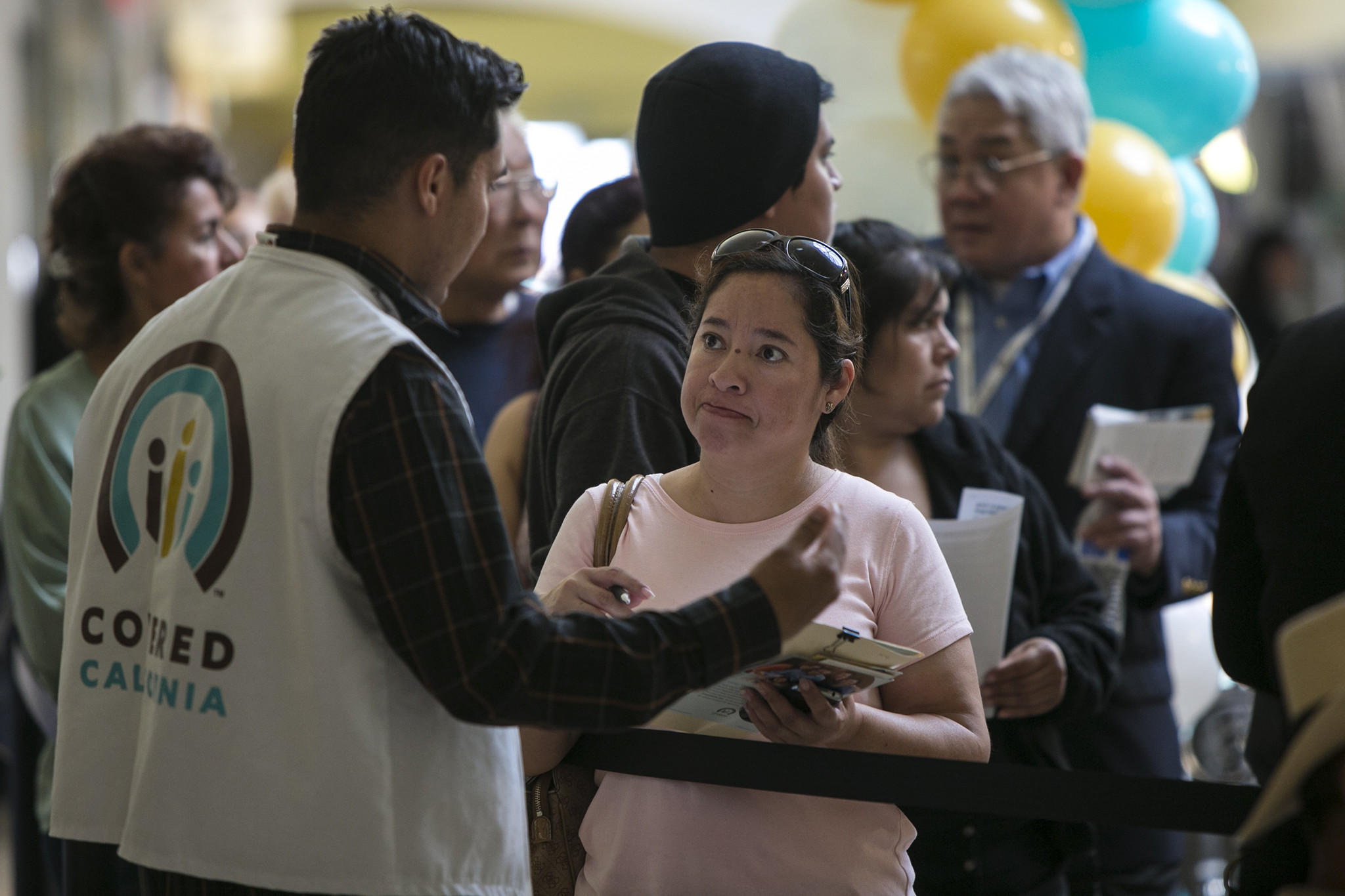 People stand in line Saturday in Panorama City, Calif., to sign up for Obamacare.
