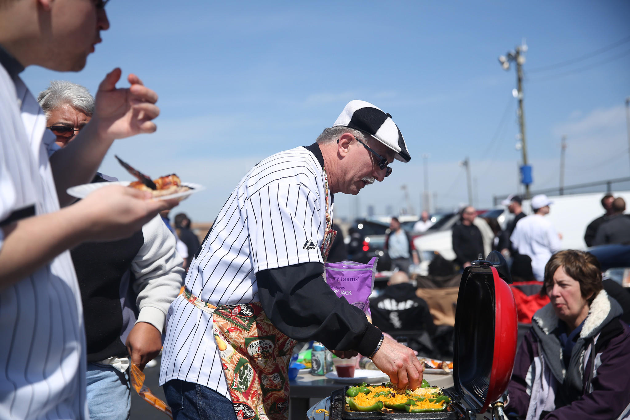 Bob Orsula prepares his special stuffed jalapeno peppers as Sox fans prepare for the home opener at US Cellular Field Monday.
