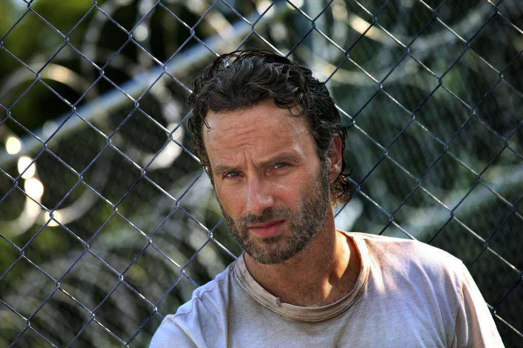 "Andrew Lincoln portrays Rick Grimes on AMC's zombie hit ""The Walking Dead."""