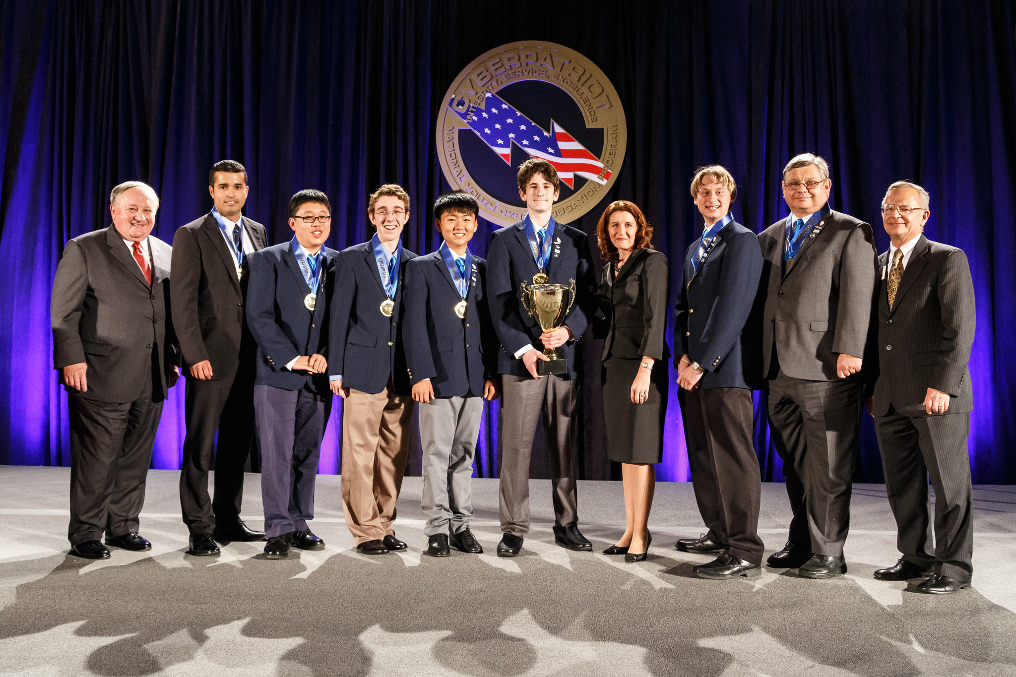 Members from North Hollywood High's Team Azure pose moments after winning the Open Division national championship at the CyberPatriot VI competition in National Harbor, Md.