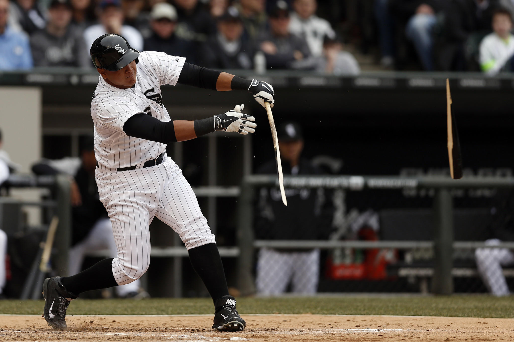 Avisail Garcia breaks his bat on a third-inning single against Minnesota Twins during the season opener at U.S. Cellular Field in Chicago on Monday.